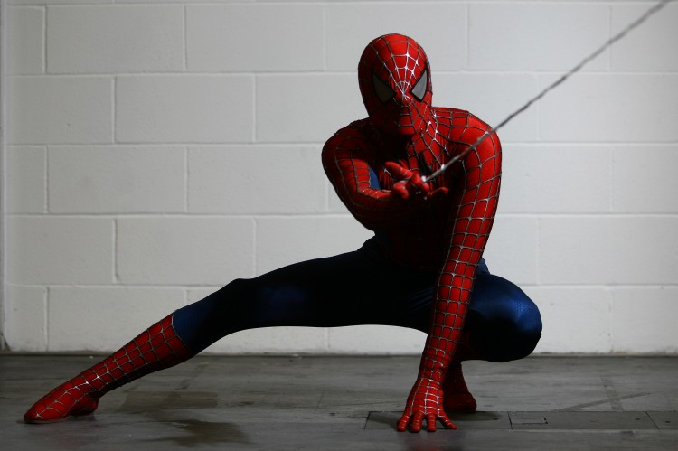 An actor dressed as Spiderman poses for a photo. (Jordan Mansfield/Getty Images)