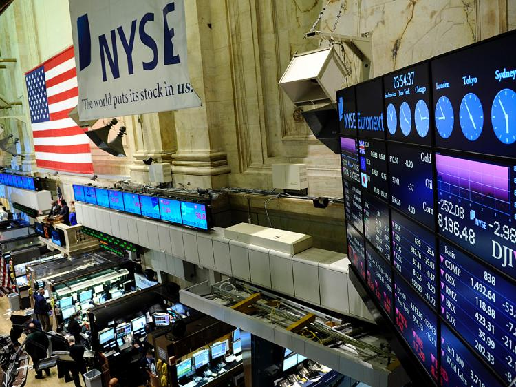 Corporate earning reports are impacting the stock market.  (Stephen Chernin/Getty Images)