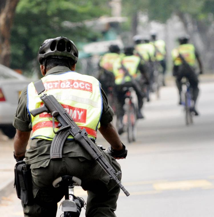 Sri Lankan security forces personnel patrol on bicycles in Colombo on January 26, 2009 a day after the army captured the Tamil Tigers' last outpost in Mullaittivu. Sri Lanka's army chief Sarath Fonseka has vowed to finish the decades old war in April. (Ishara S. KODIKARA/AFP/Getty Images)