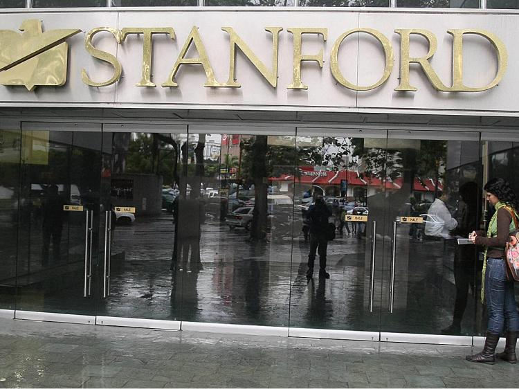 The main entrance to the headquarters of the Standford Bank in Caracas, seized by the Venezuelan government after owner Allen Stanford was accused of defrauding investors around the world.   (Pedro Rey/AFP/Getty Images)