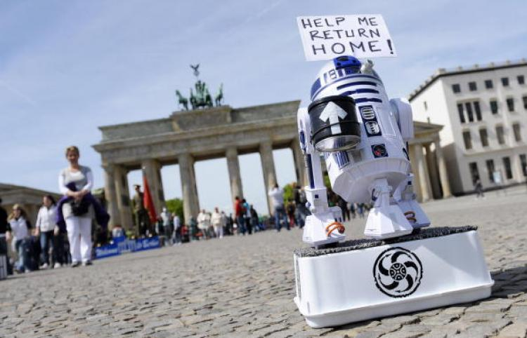 Star Wars Day 2010: May the 4th be With You! The robot R2D2 from the Star Wars movies collects money for his journey home in front of the Brandenburg Gate in Berlin on May 5, 2010. (Michael Gottschalk/AFP/Getty Images)