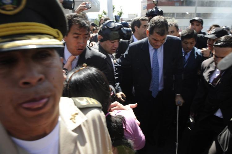 State of Siege: Ecuadorean President Rafael Correa (C) arrives at Regimiento Quito barracks in Quito on Sept. 30. (Rodrigo Buendia/AFP/GETTY IMAGES)