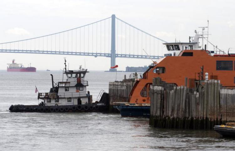 Staten Island Ferry Crash: A tug boat stands ready by the Staten Island Ferry Andrew J. Barberi which crashed May 8 into a pier at the dock on Staten Island. (Don Emmert/AFP/Getty Images)