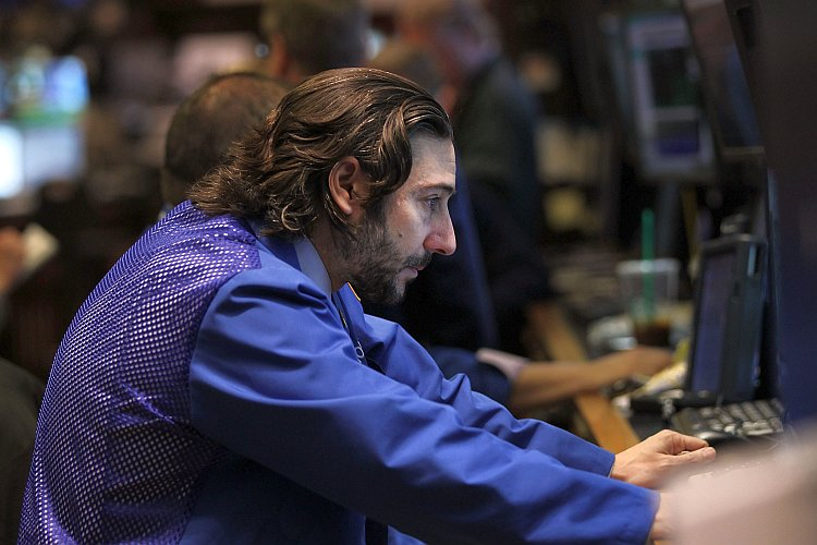 A trader looks at his screen at the New York Stock Exchange