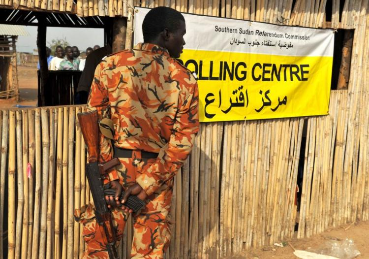 A soldier guards a polling station in Juba, on Jan. 9, on the first day of a week-long independence referendum expected to lead to the partition of Africa's largest nation and the creation of the world's 193rd U.N. member state. (Roberto Schmidt/AFP/Getty Images)