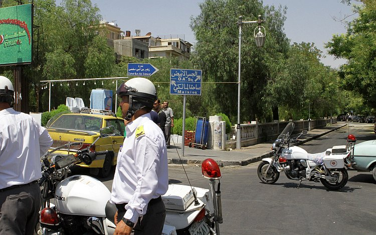 Syrian police guard the road