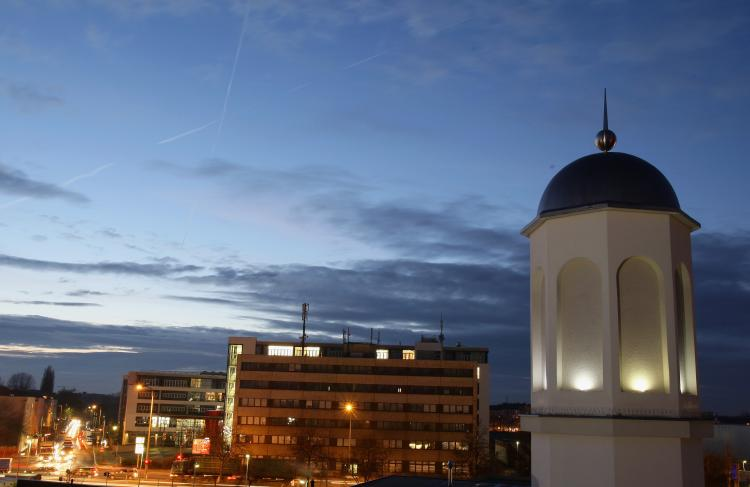 A minaret stands illuminated over the Khadija mosque on Dec. 3 in Berlin, Germany. A recent referendum in Switzerland, in which 57 percent of respondents voted for a ban on the construction of minarets, has sparked a debate across Europe over attitudes to (Andreas Rentz/Getty Images)