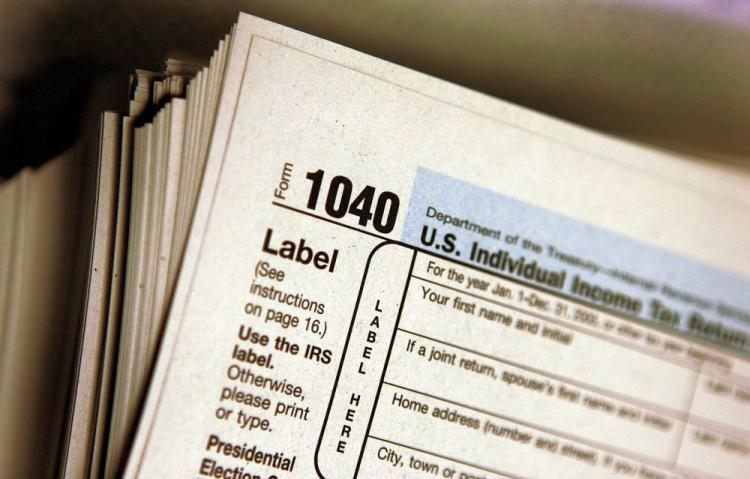 The top lawyer in California warned citizens not to fall prey to companies offering up front fees and tax debt relief. (Tim Boyle/Getty Images)