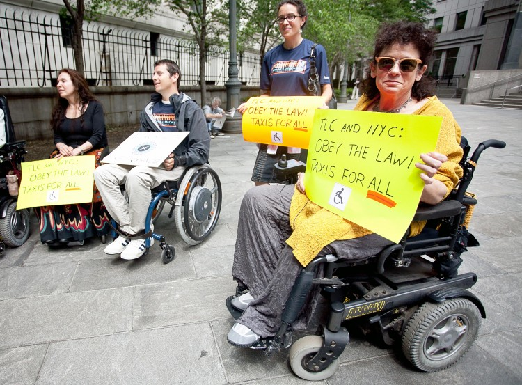 ACCESS: Advocates for wheelchair accessible taxis gathered at U.S. District Court in Lower Manhattan on Tuesday.  (Amal Chen/The Epoch Times)