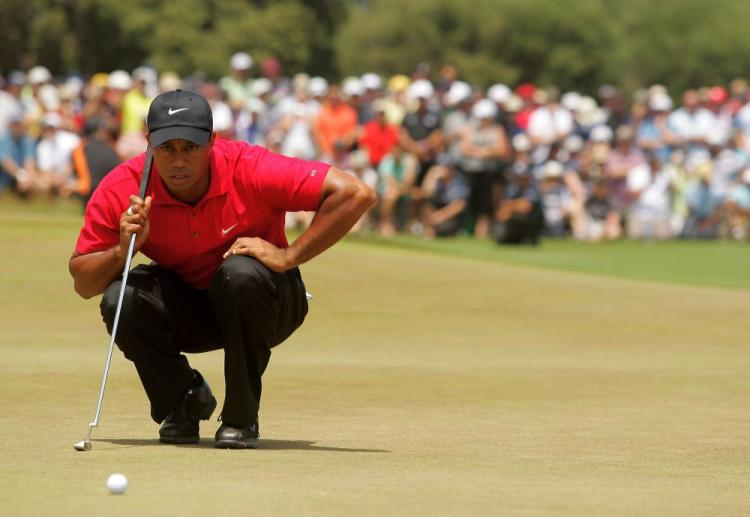 Tiger Woods prepares to putt during the final round of the Australian Masters.  (Mark Dadswell/Getty Images)