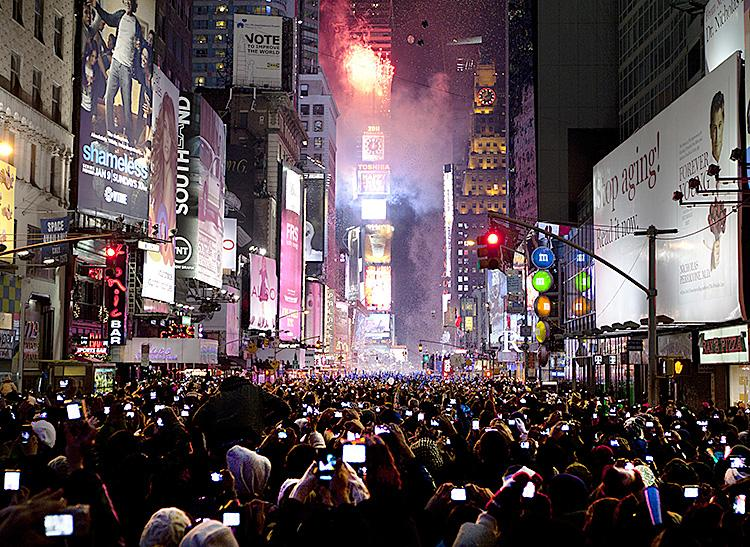 Ball Drop 2011: Times Square lights up at midnight EST, announcing 2011 in New York City. (Edward Dai/The Epoch Times)