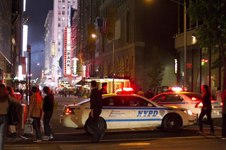 Police cordoned off a significant portion of Times Square, Manhattan, after police were alerted to a possible bomb in the area.  (Jan Jekielek/The Epoch Times)