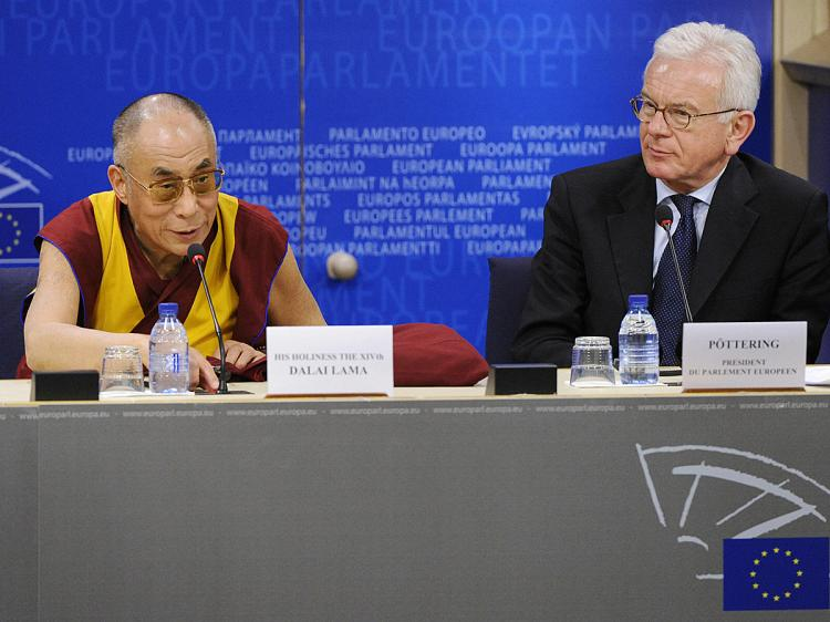 European Parliament President Hans-Gert Poettering (R) and exiled Tibetan spiritual leader Dalai Lama speak to the press at the EU Parliament in Brussels on December 4, 2008. (John Thys/AFP/Getty Images)