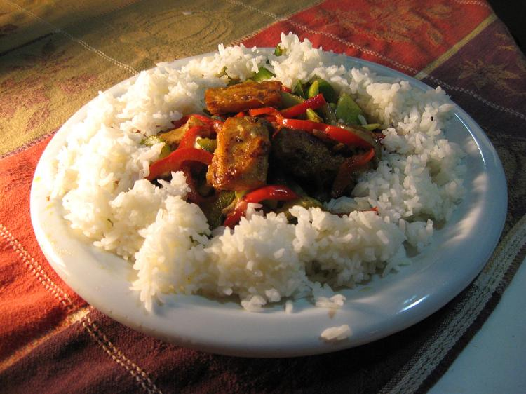 COOKING TOFU: Cut tofu in 1-inch cubes and roll in flour or cornstarch. (Maureen Zebian/The Epoch Times)
