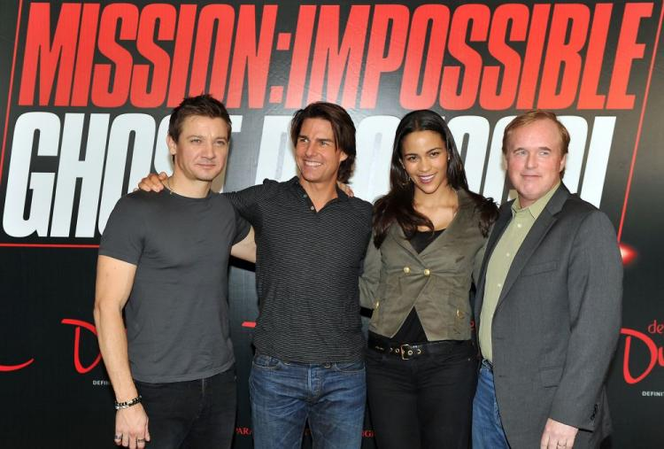 Tom Cruise (Center-Left), actor Jeremy Renner (L), actress Paula Patton and director Brad Bird (R) pose for a picture after holding a press conference about their upcoming film 'Mission: Impossible Ghost Protocol' in the Gulf emirate of Dubai on October 2. (AFP/Getty Images)