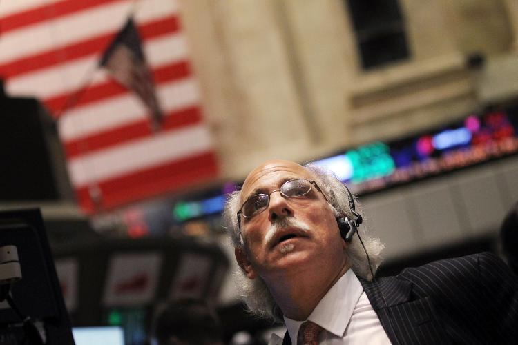 STOCKS SOAR: A trader works on the floor of the New York Stock Exchange (NYSE) in New York City. U.S. stocks rallied on Monday, sending the Dow Jones Industrial Average up 208 points on the first day of trading in August.  (Mario Tama/Getty Images)