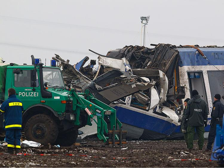 Emergency staff work at the scene of an accident where a passenger train collided head on with a goods train on January 30, 2011 in Hordorf near Oschersleben, Germany. (Marco Prosch/Getty Images)