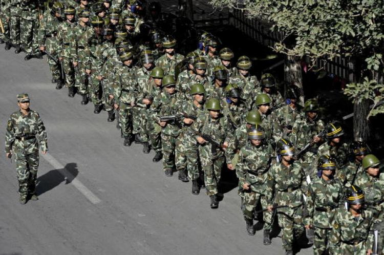 Chinese troops march along a street of Urumqi, the capital of the Xinjiang Uyghur autonomous region, on September 5, 2009.  (Philippe Lopez/AFP/Getty Images)