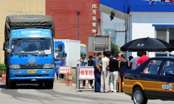Truckers get their registration checked. In some areas in China, drivers are forced to pay fines that sometimes bought exemption from a traffic law violation for several months. (Frederic J. Brown/AFP/Getty Images)