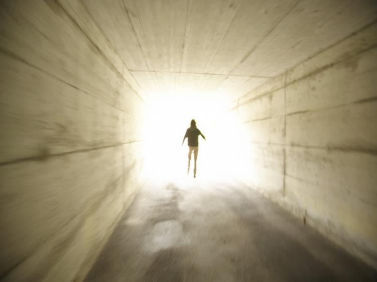 Many people who came close to death told of experiences of passing through a tunnel into a bright light.  (Photos.com)