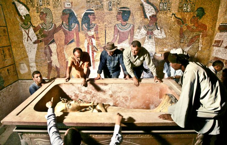 Egypt's antiquities chief Zahi Hawass (rear C) supervises the removal of King Tutankhamun from his stone sarcophagus in his underground tomb in the famed Valley of the Kings in Luxor, Nov. 4, 2007.  (Ben Curtis/AFP/Getty Images)