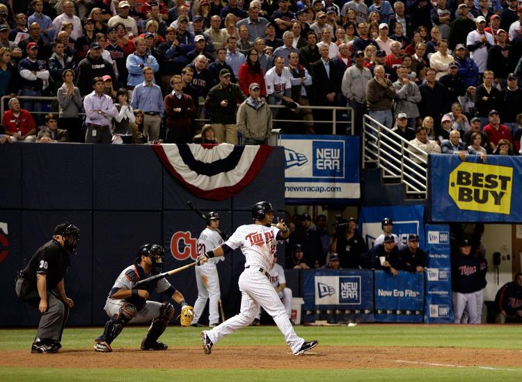 WALK OFF SINGLE: Alexi Casilla of the Minnesota Twins drives in game-winning run as the Twins defeat the Detroit Tigers to win the American League tiebreaker 6-5 in 12 innings. (Jamie Squire/Getty Images)