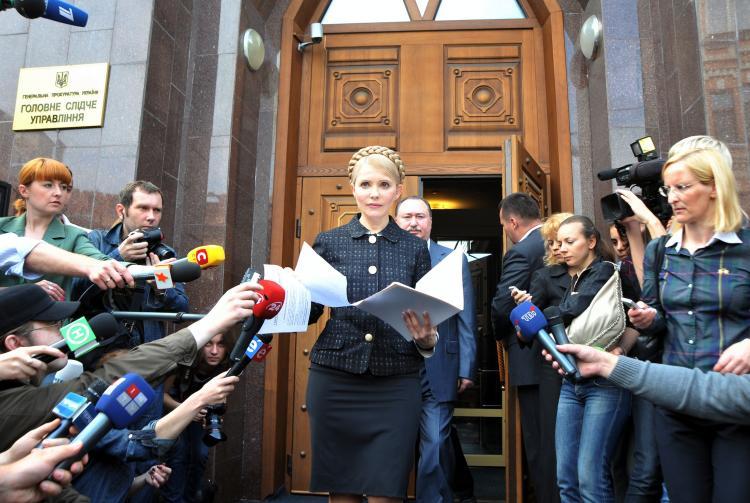 Yulia Tymoshenko (C) walks out of the prosecutor general's office in Kyiv on May 12.  (Genya Savilov/AFP/Getty Images)