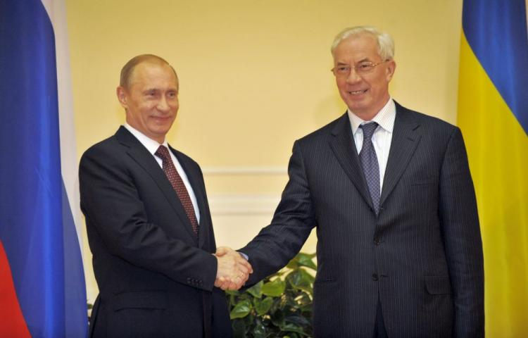 Ukraine's Prime Minister Mykola Azarov (R) welcomes his Russian counterpart Vladimir Putin prior their talks in Kyiv late April 26, 2010. (Sergei Supinsky/AFP/Getty Images)