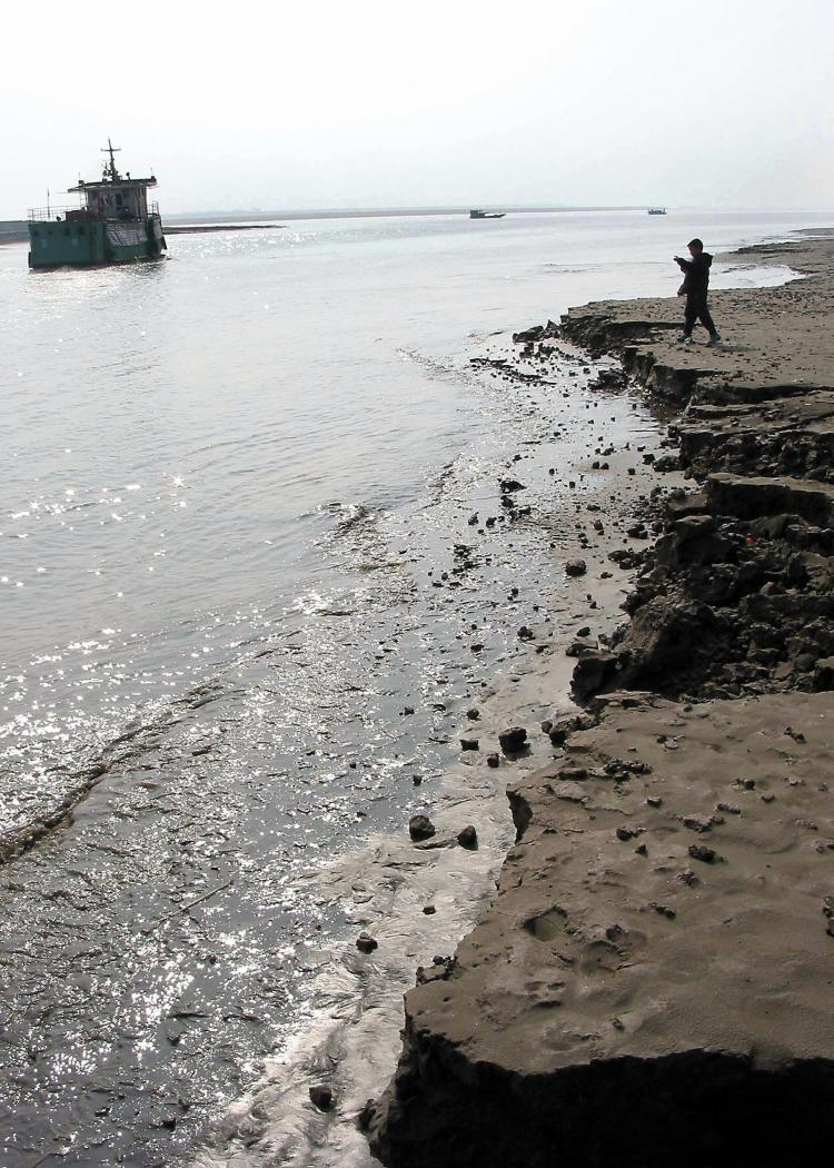 The banks of the Yangtze River. An uranium mine employee claims that mine employees have poured improperly-handled radioactive materials into the Yangtze River, effectively contaminating the water. (STR/AFP/Getty Images)