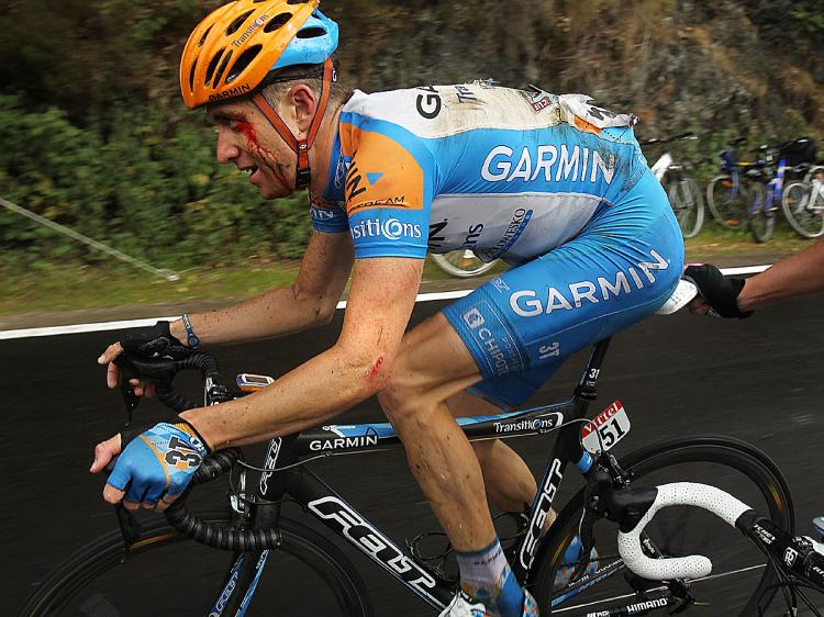 Christian VandeVelde rides to the end of Stage Two of the 2010 Tour de France with cuts, bruises, and broken bones. (Spencer Platt/Getty Images)