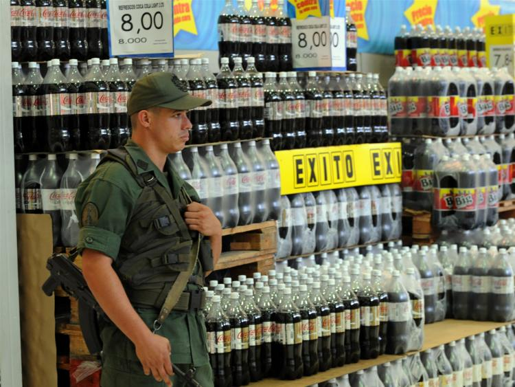 A member of the Venezuelan National Guard stands guard in one of the aisles at a supermarket on January 11, 2010 in Caracas.  (Juan Barreto/AFP/Getty Images)
