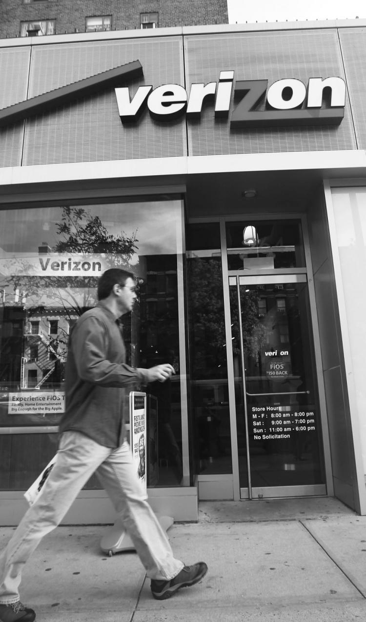 A man walks by a Verizon store Monday in New York City. (Mario Tama/Getty Images )