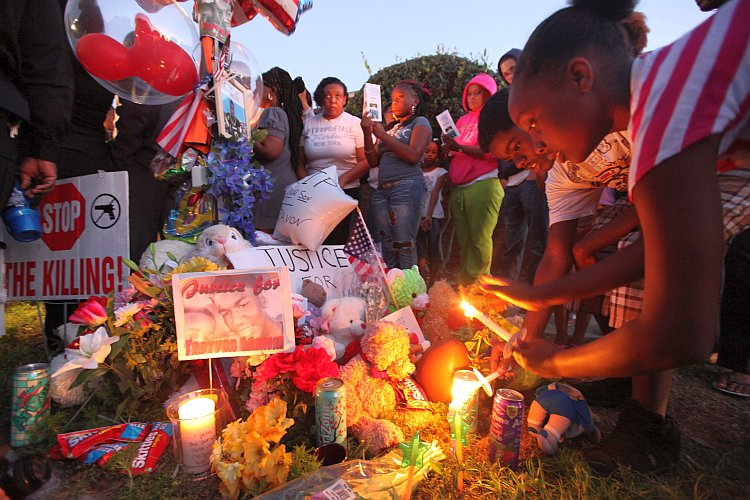 Supporters gather during a candelight vigil at a memorial to Trayvon Martin