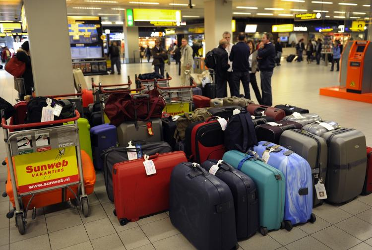 Passengers wait after flights were cancelled at the Schiphol Airport, outside Amsterdam on May 17, 2010.  (Toussaint Kluiters/AFP/Getty Images)