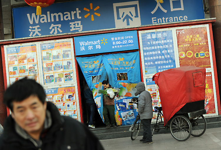 Chinese shoppers leave a Walmart store