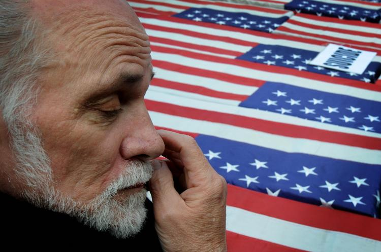 Vietnam War veteran and author of the book 'Born on the Fourth of July' Ron Kovic reacts in front of mock coffins during a protest to mark the sixth anniversary of the Iraq war in Hollywood on March 21, 2009. (Mark Ralston/AFP/Getty Images)