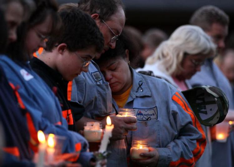 West Virginia Mine Tragedy: People participate in a candlelight vigil to honor the coal miners that were killed, on April 10 in Montocal, West Virginia. On April 5, a methane gas explosion killed 29 coal miners at the Massey Energy Company's Upper Big Bra (Mark Wilson/Getty Images)