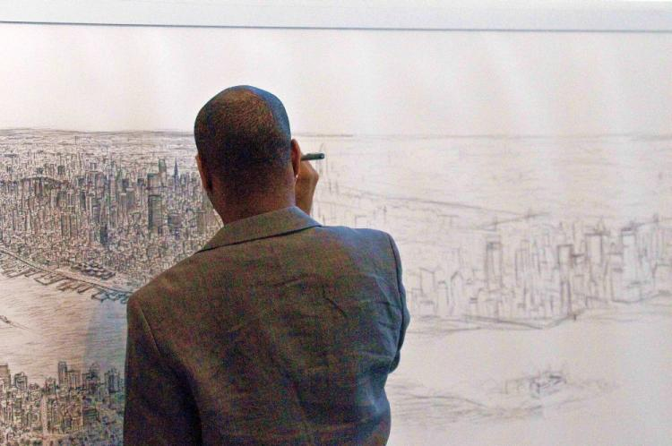 DRAWING THE CITY: Autistic artist Stephen Wiltshire draws Manhattan from memory at the Pratt Institute, in Brooklyn.  (Dan Skorbach/The Epoch Times)