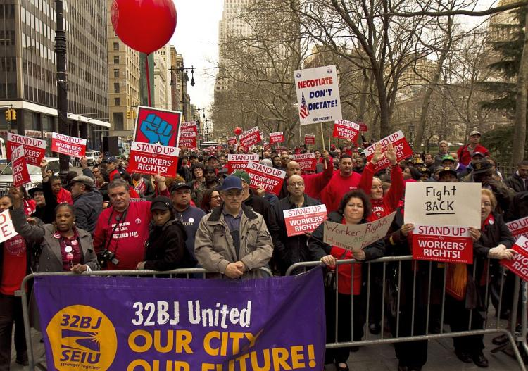 UNIONS REMEMBER KING: Union workers gather at City Hall Park on Monday to remember Martin Luther King Jr.'s support of worker rights before he was shot on April 4, 1968.  (Phoebe Zheng/The Epoch Times)