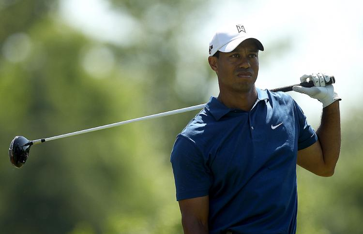 DISMAYED, REJECTED: Tiger Woods reacts to a poor tee shot on the 9th hole during the second round of the Quail Hollow Championship. (Streeter Lecka/Getty Images)