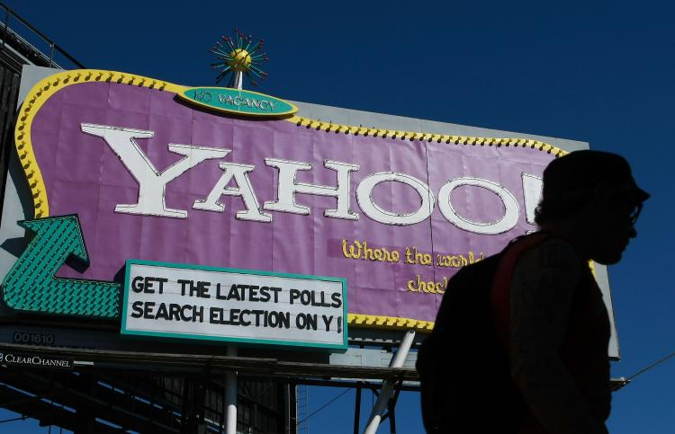 A pedestrian walks by a Yahoo billboard October 21, 2008 in San Francisco, California. Yahoo reported a fourth-quarter loss of $303 million as CEO Jerry Yang exited after a tumultuous tenure as CEO. (Justin Sullivan/Getty Images)