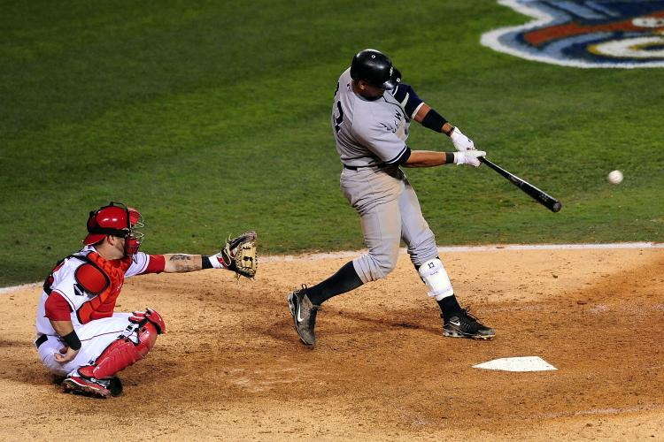 Alex Rodriguez #13 of the New York Yankees hits a double to left field during the ninth inning in Game Four of the ALCS against the Los Angeles Angels of Anaheim during the 2009 MLB Playoffs at Angel Stadium on October 20, 2009 in Anaheim, California. (Jacob de Golish/Getty Images)