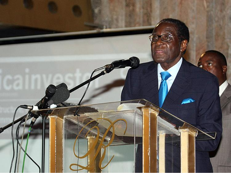 On March 1, a new law went into effect giving foreign companies worth at least $500,000 a time limit to transfer majority ownership to native black Zimbabweans. President Robert Mugabe seen here. (Jekesai Njikizana/AFP/Getty Images)