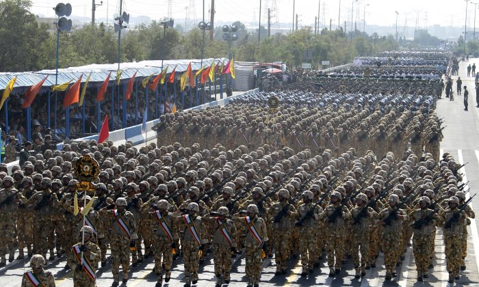 The Iranian army marches during an annual military parade which marks Iran's eight-year war with Iraq, in Tehran, on Sept. 21, 2012. (Atta Kenare/AFP/GettyImages)