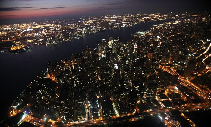 Lower Manhattan is lit up as night falls September 13, 2009, in New York City. Business leaders and security experts are looking for new ways to prevent nation-state cyberattacks. (Mario Tama/Getty Images)