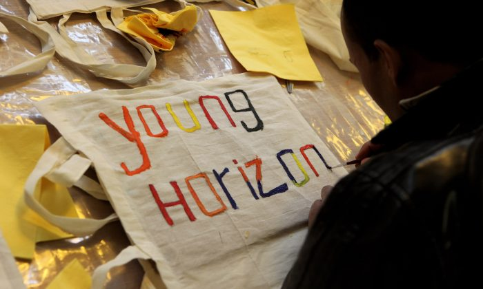 Young people attend an art workshop on the opening day of the New Horizons Youth Centre in Camden, London on February 23, 2010. The charity has given night bus tickets to young homeless due to a lack of hostel beds. (Oli Scarff/Getty Images)