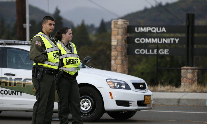 Sheriff's deputies man a roadblock on the road leading to Umpqua Community College Saturday, Oct. 3, 2015, in Roseburg, Ore. (AP Photo/John Locher)