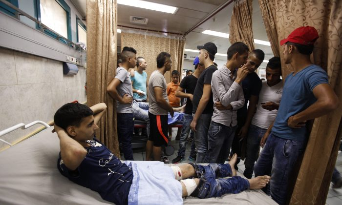 A Palestinian lies in hospital after he was wounded during an Israeli military raid in the West Bank city of Jenin, Sunday, Oct. 4, 2015. (AP Photo/Majdi Mohammed)