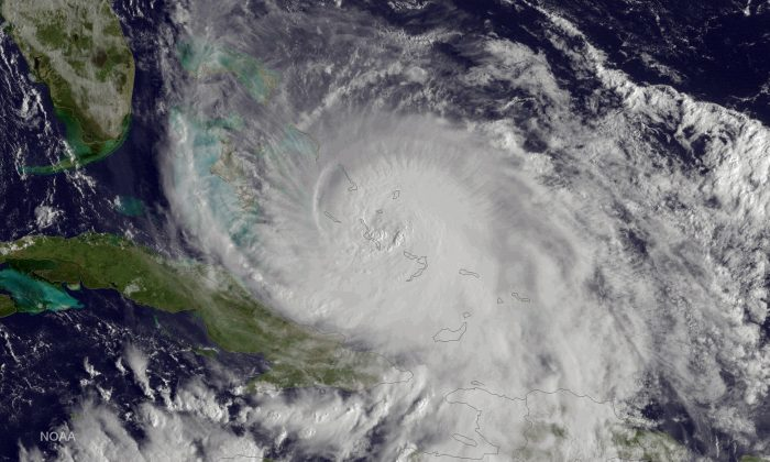 This satellite image taken Friday, Oct. 2, 2015 at 8:45 a.m. EDT, and released by the National Oceanic and Atmospheric Administration (NOAA), shows Hurricane Joaquin of the Bahamas.  (NOAA via AP)