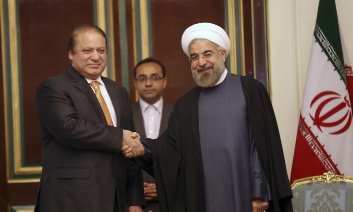 Iranian President Hassan Rouhani (R) shakes hands with Pakistani Prime Minister Nawaz Sharif at the start of their meeting in Tehran, Iran, on May 11, 2014.  (Vahid Salemi/AP)